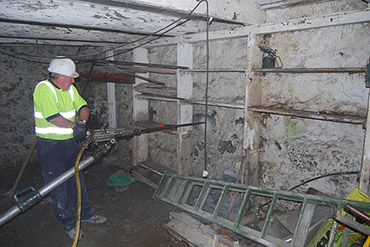 Probe drilling within a confined space (basement), to establish a rock profile in Helston, Cornwall.